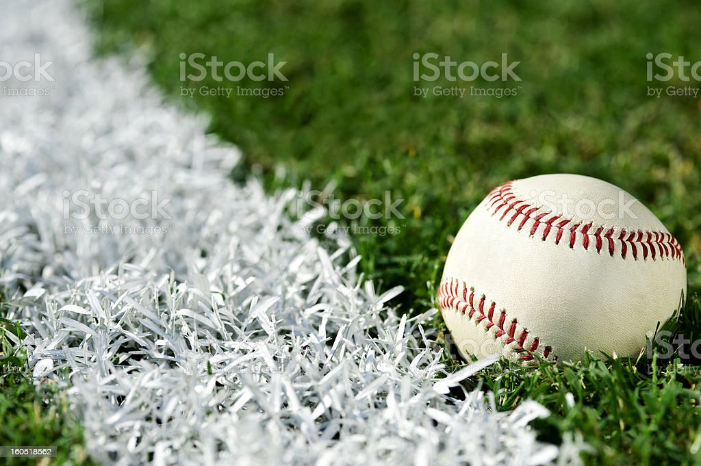 New Baseball along foul line stock photo