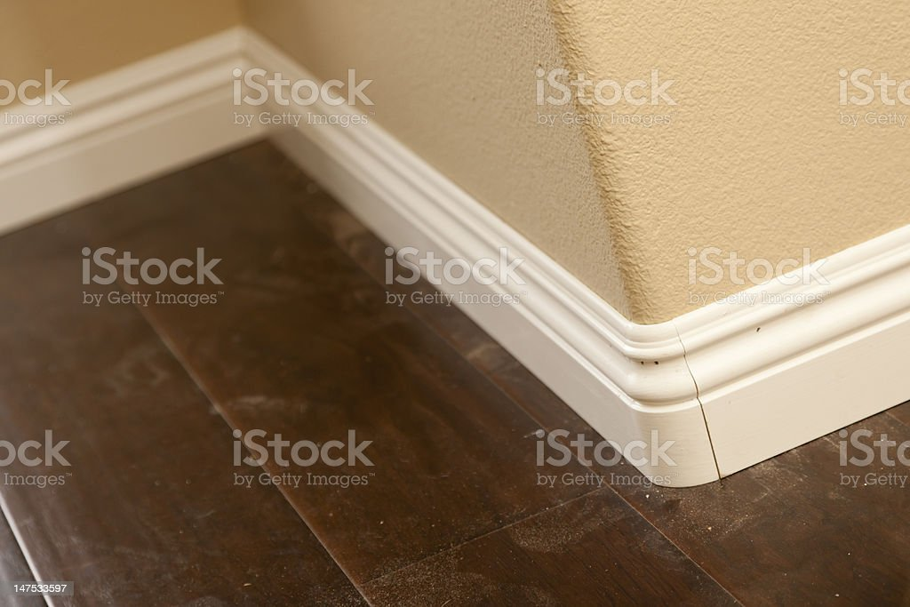 New Baseboard, Bull Nose Corners with Newly Installed Laminate Flooring stock photo