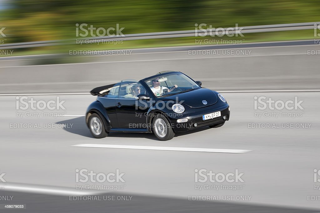 VW New Beetle convertible, high speed stock photo