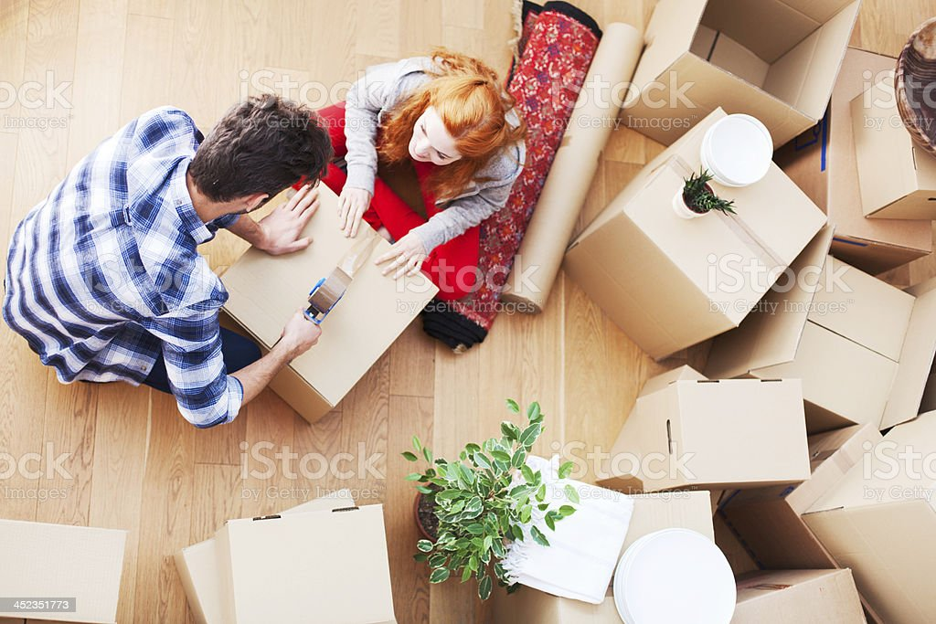 New beginings, couple unpacking at home. stock photo