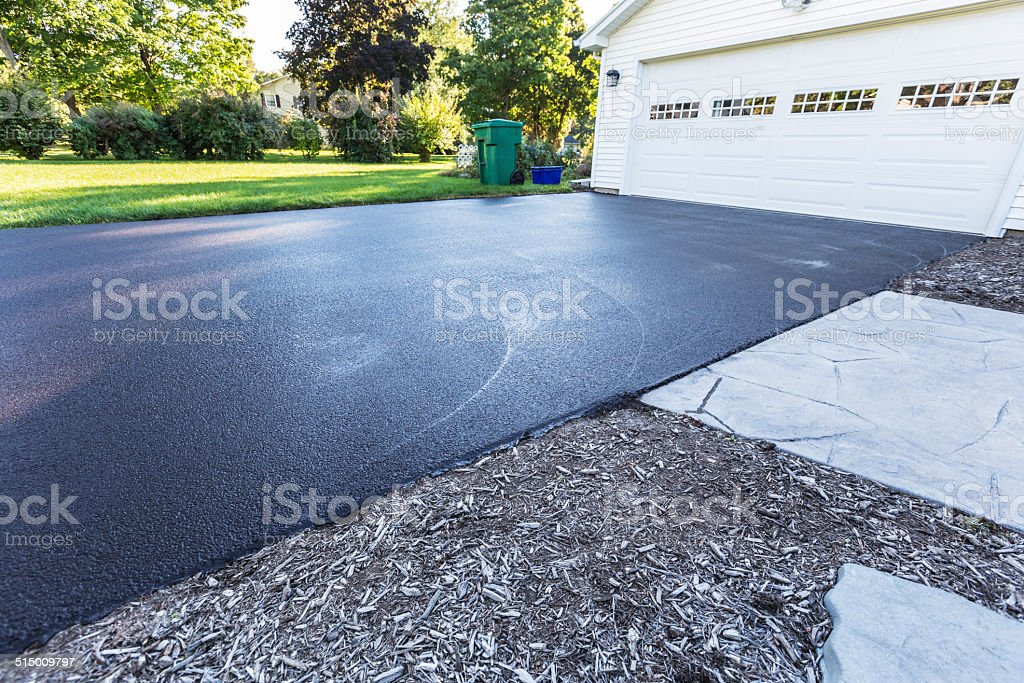 New Blacktop Asphalt Driveway stock photo