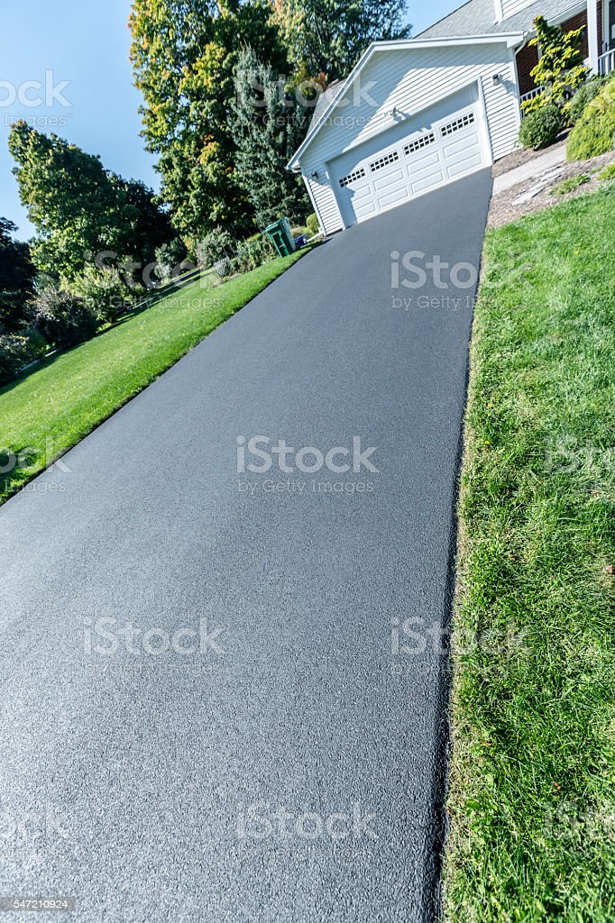 New Blacktop Sealant Covered Residential Home Asphalt Driveway stock photo