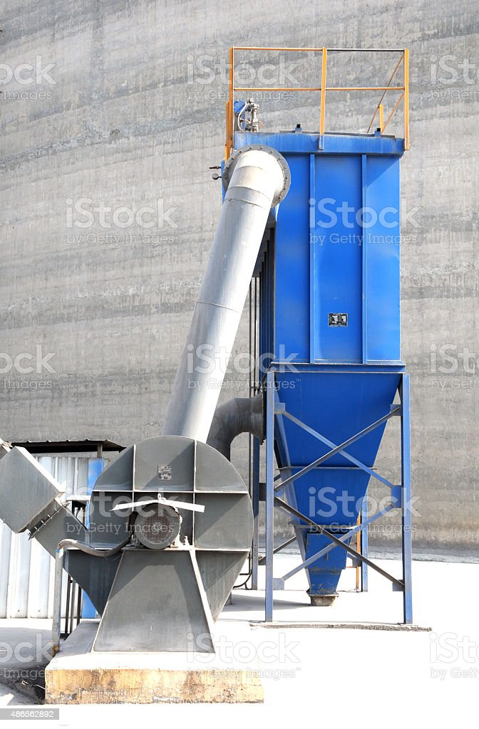 new blue dust collector with electric machine stock photo