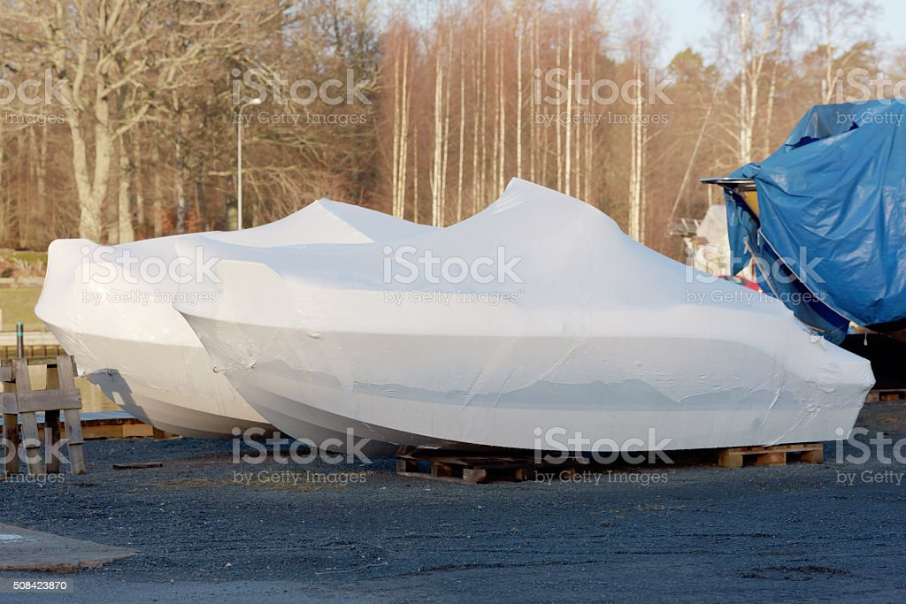 New boats in plastic casing stock photo
