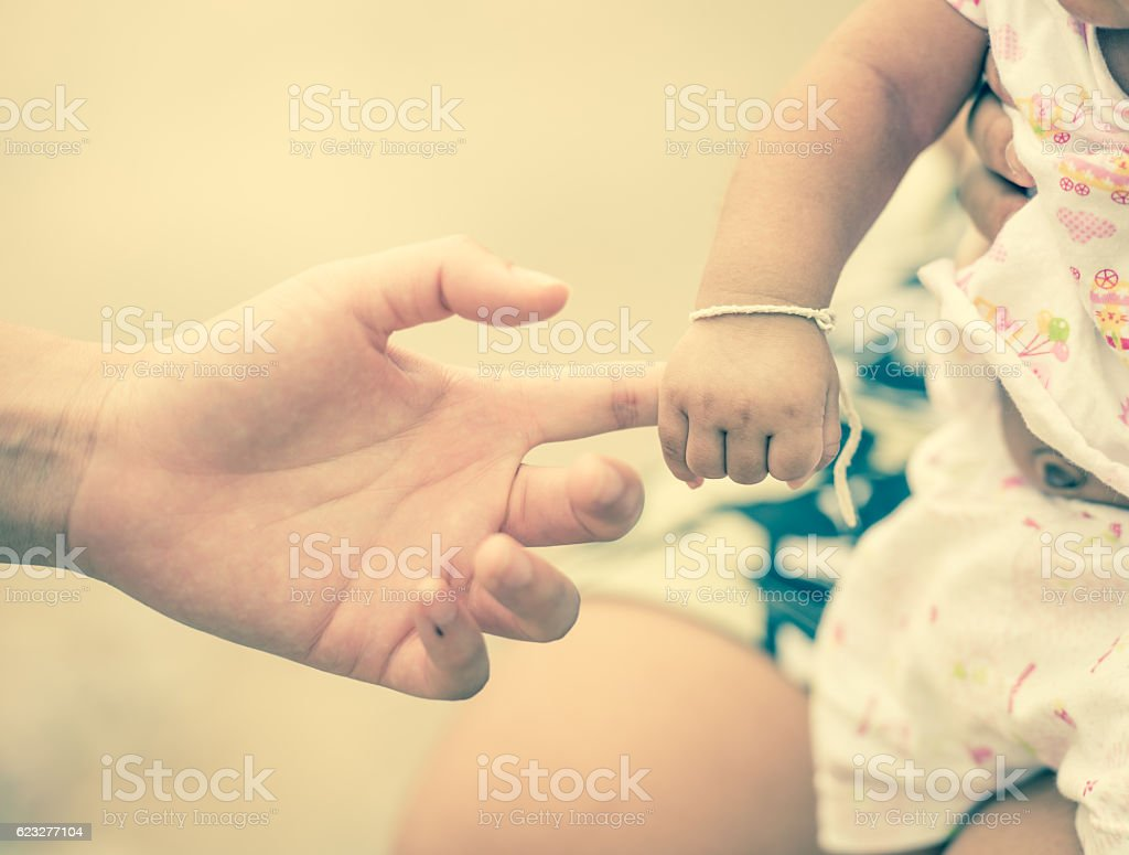 New born baby hand ; vintage tone style stock photo