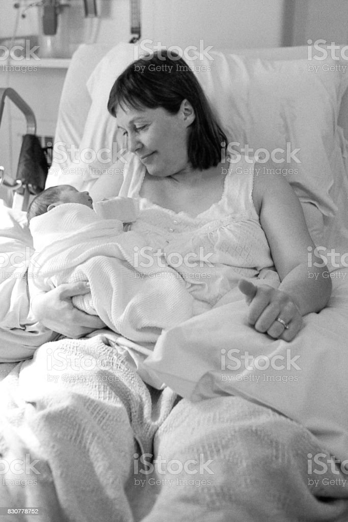 Black and white image of sleeping new born baby boy, requiring...