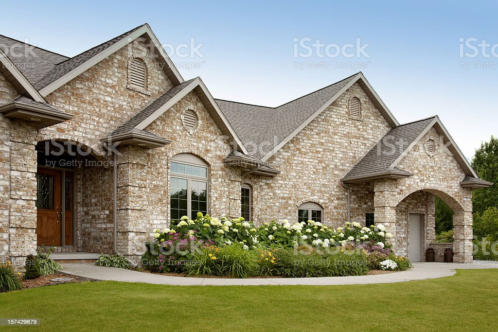 New Brick Home With Architectural Asphalt Shingle Roof, Flower Garden stock photo