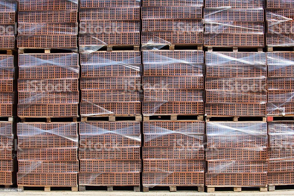 New bricks on stacked pallets stock photo