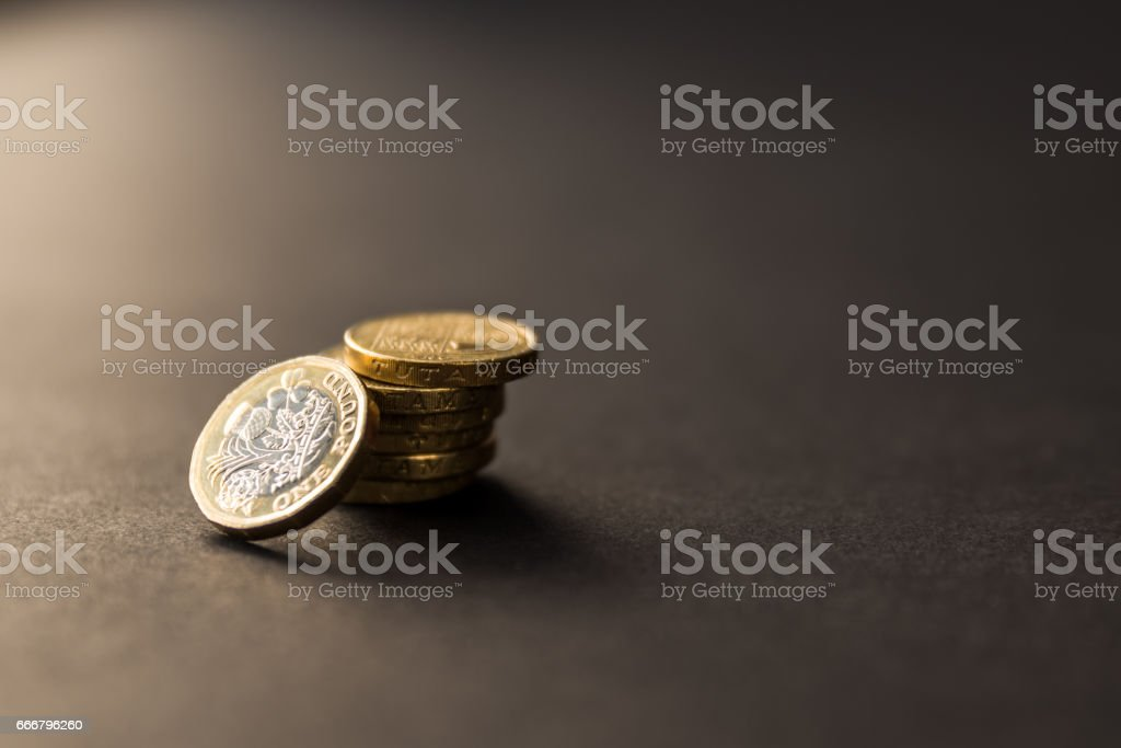 New british one sterling pound coin on dark background stock photo