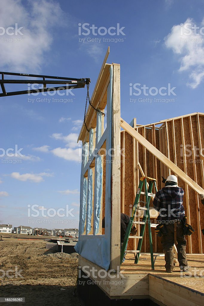New Build Vertical with Construction Worker stock photo