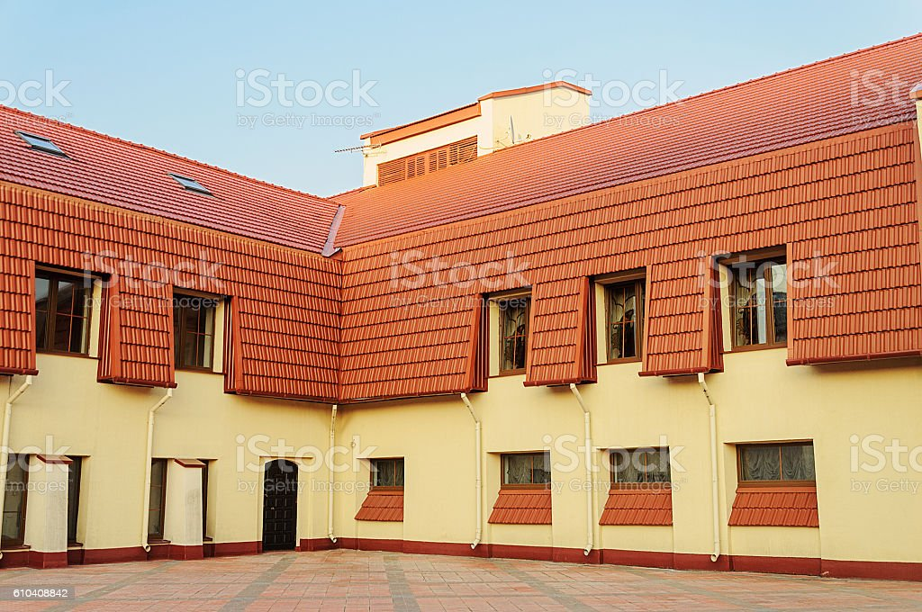 New building with red tiled roof stock photo