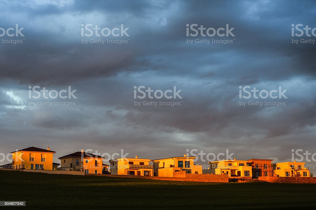 New buildings of the settlement at sunset with clouds stock photo
