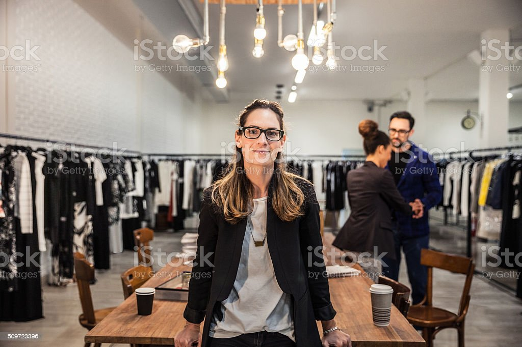 New Business employee of a clothing store stock photo
