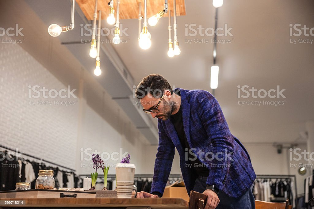 New Business owner working on business plans stock photo