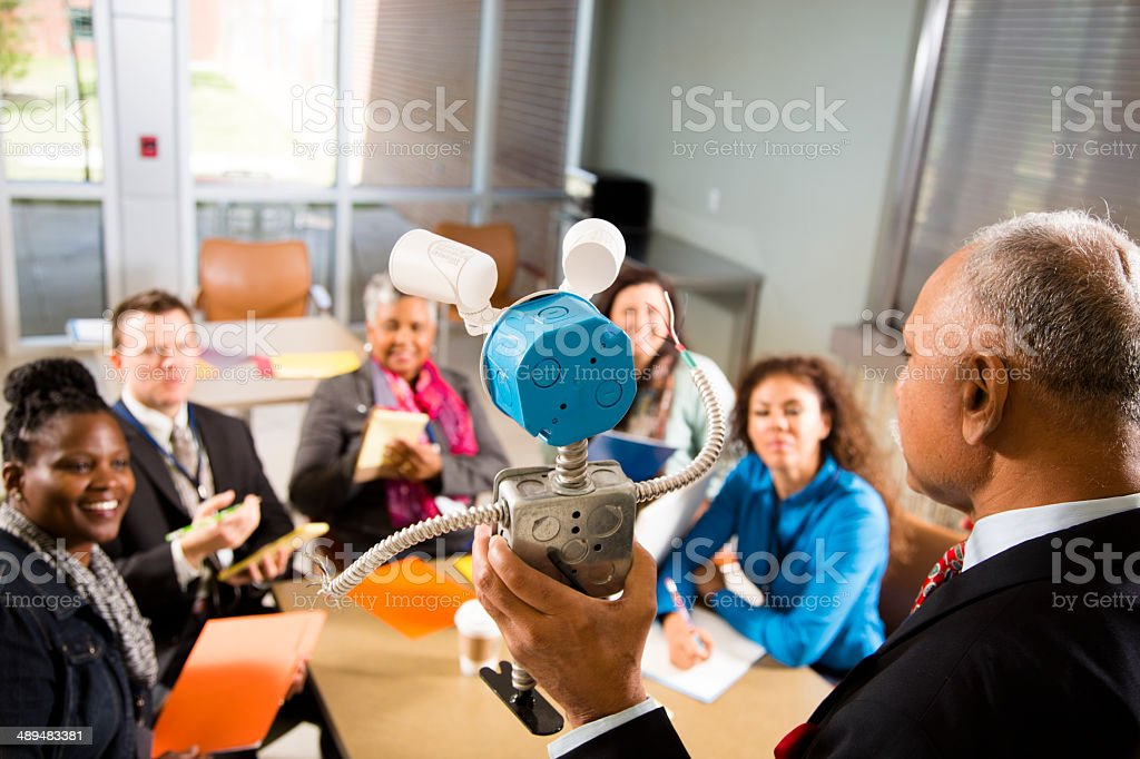 New business start-up. Man demonstrates invention, prototype. stock photo