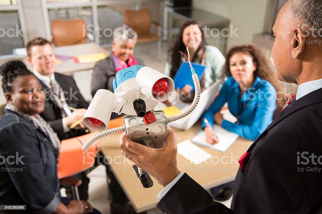 New business start-up. Man demonstrates invention, robot prototype. stock photo