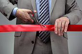 New business venture cutting a red ribbon