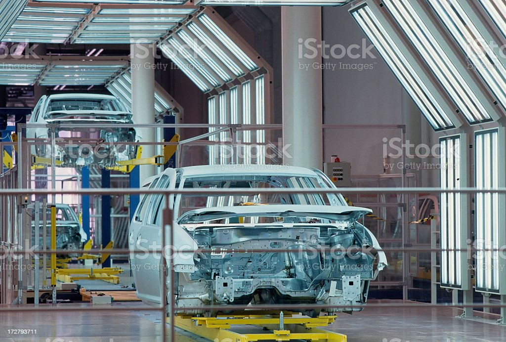 A new car chassis is assembled in a manufacturing plant royalty-free stock photo