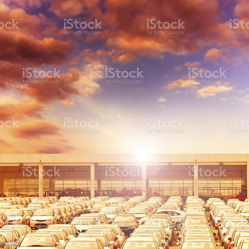 New Car Sales Lot with sun royalty-free stock photo