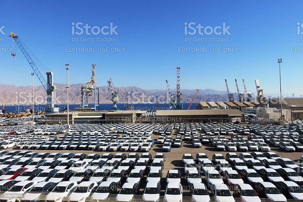 new cars covered in protective white sheet stock photo