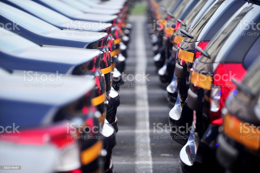 New cars in line stock photo
