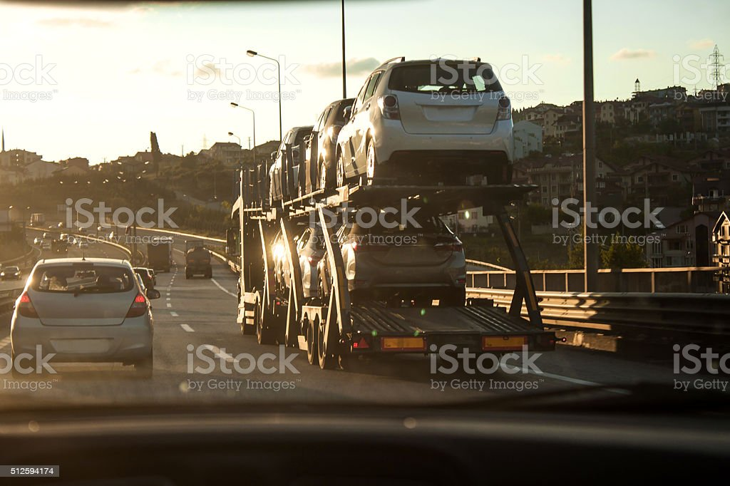 New cars transportation in traffic stock photo