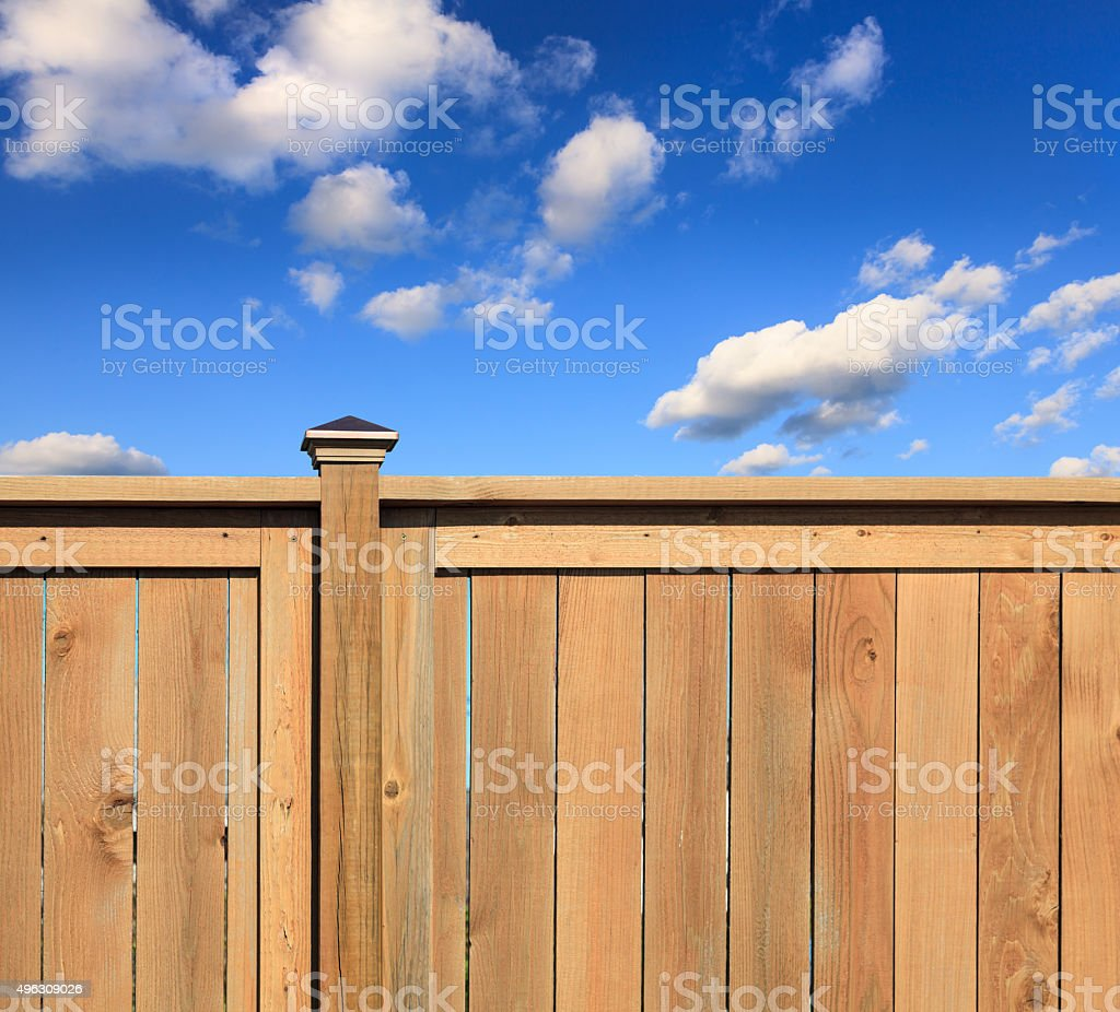 New cedar fence stock photo