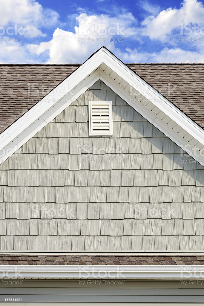 New Cedar style vinyl siding, soffit, asphalt roofing stock photo