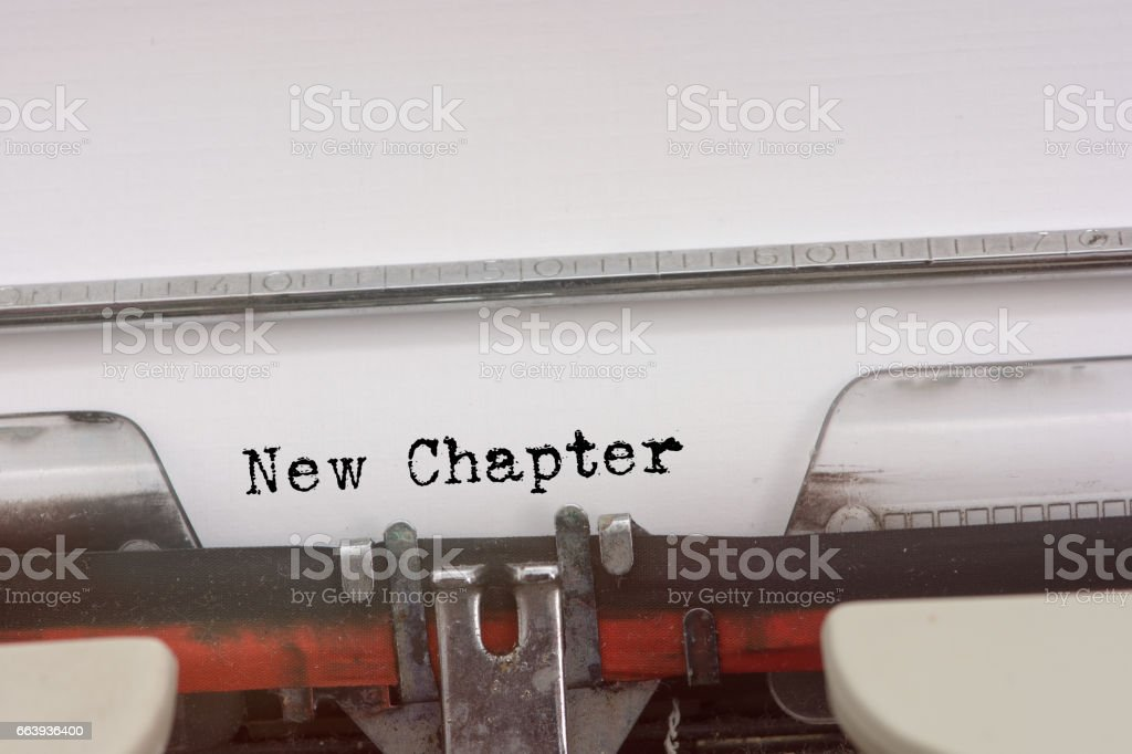 New Chapter word typed on a Vintage Typewriter. stock photo