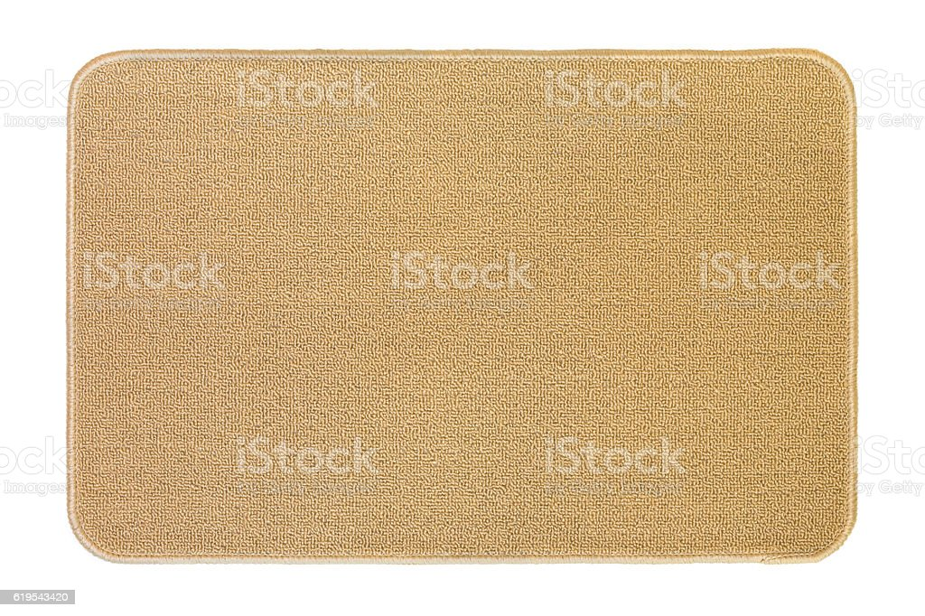 New clean floor rug, doormat in beige isolated on white stock photo