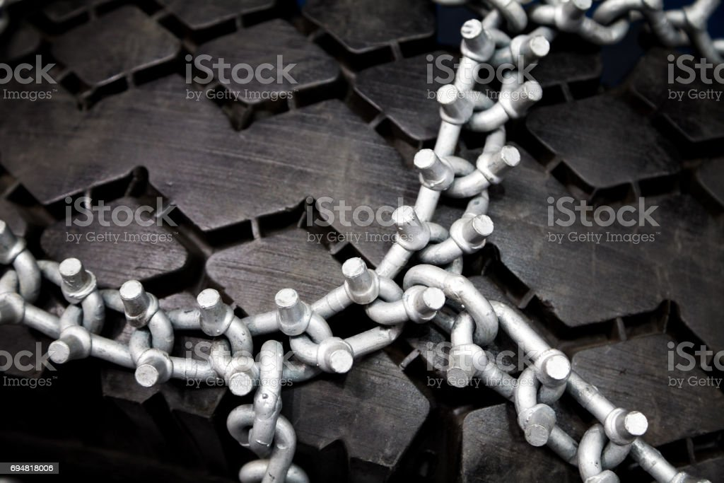 New clean studded tire chains close-up stock photo