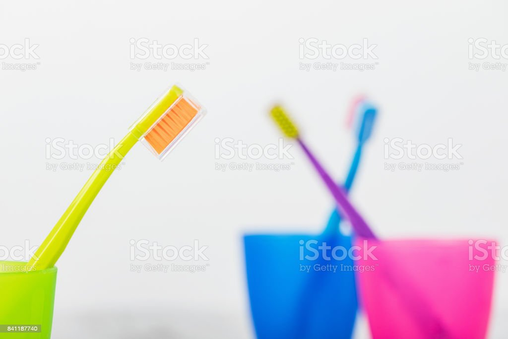 New color ultra fine toothbrushes in colorful glasses. Dental Industry. various types of toothbrushes. Beautiful smile concept. Whitening. Tooth care. Teeth healthy concept. stock photo