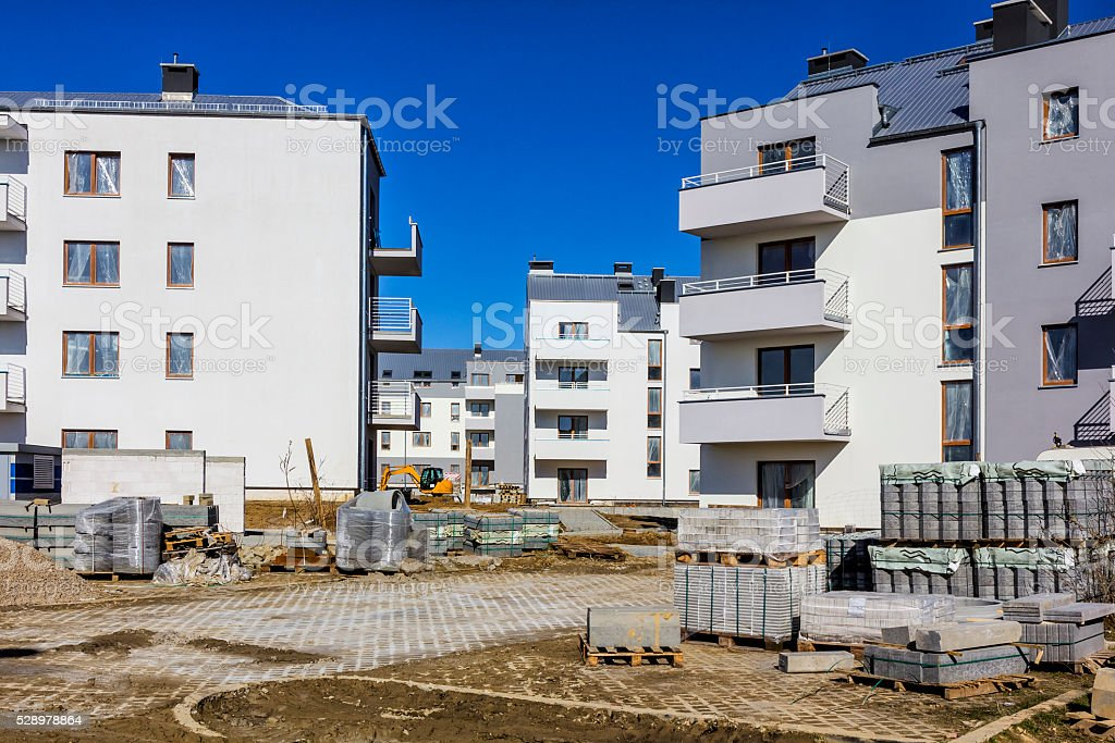 New complex of white apartment buildings under construction stock photo