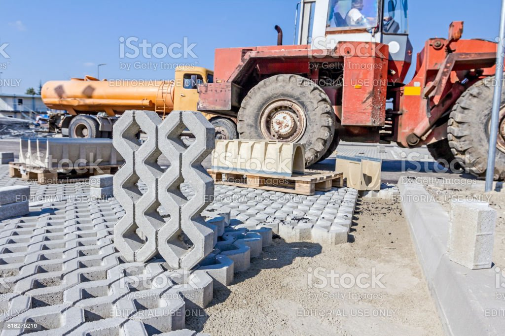 New concrete prefabricated drainage parts for parking lot at building site. stock photo