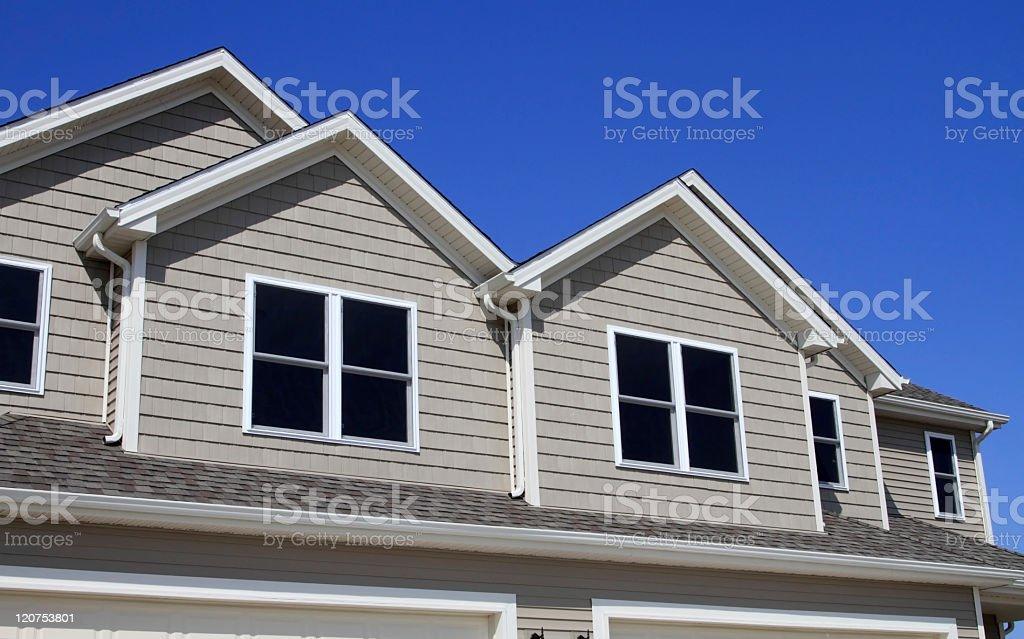 New Construction, gutters, vinyl siding, roof shingles royalty-free stock photo