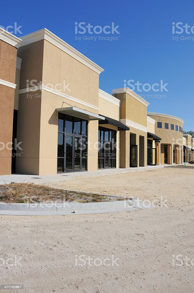 New Construction Strip Mall Shopping Center Storefront royalty-free stock photo
