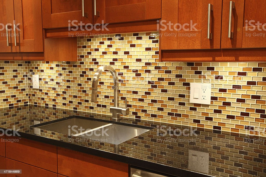New contemporary luxury kitchen - goose neck faucet stock photo