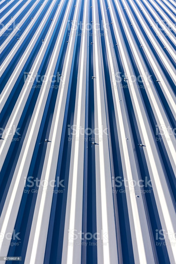 new corrugated metal roof on top of industrial building stock photo