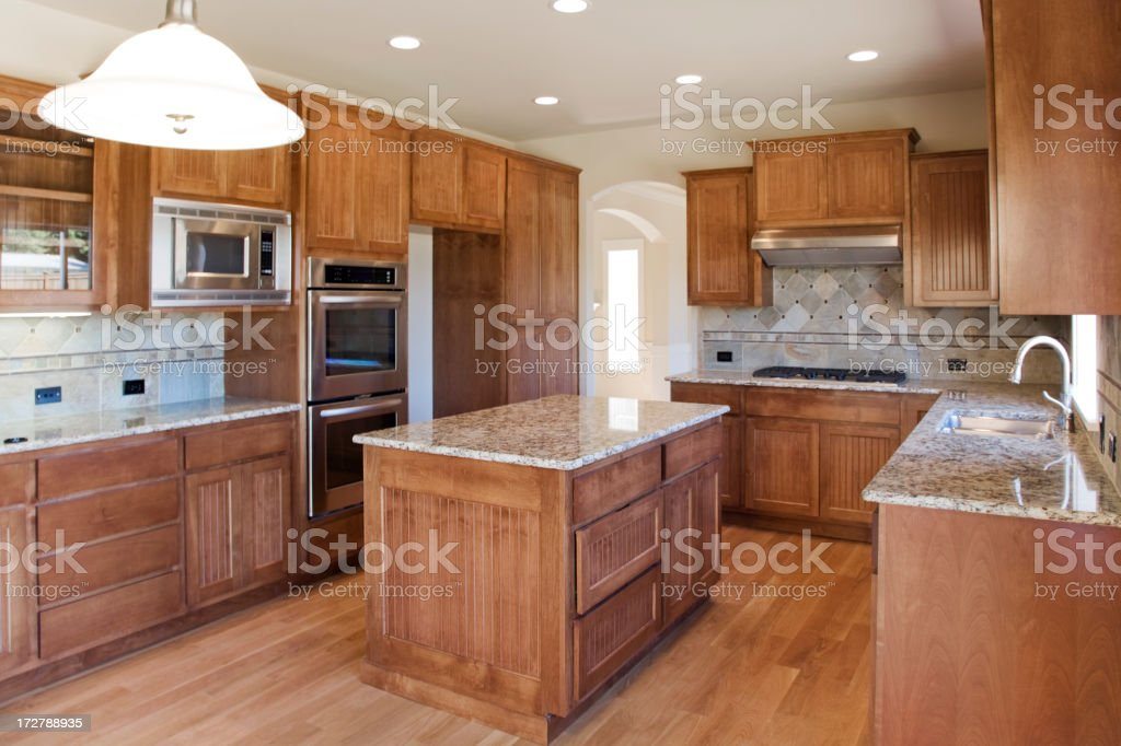 New Custom kitchen with granite counters royalty-free stock photo
