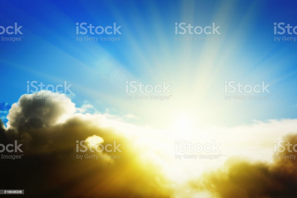 New day dawning: glorious sunrise over fluffy clouds stock photo
