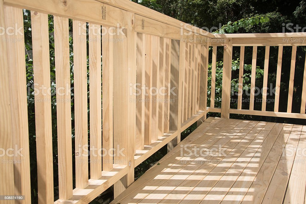 New deck patio built of wood, pine timber stock photo