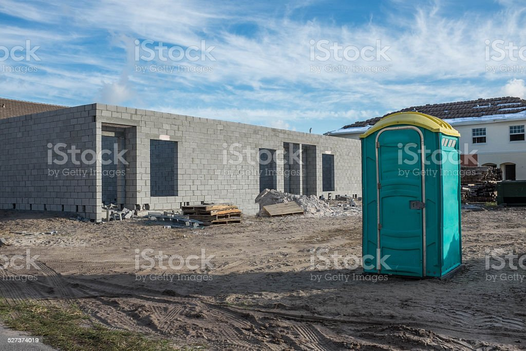 New Development Construction Zone with Outhouse stock photo