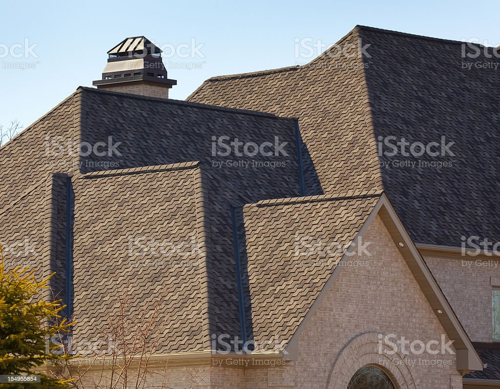 New Dimensional Asphalt Shingle Complex Roof on Mansion stock photo