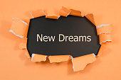 new dreams written under torn paper