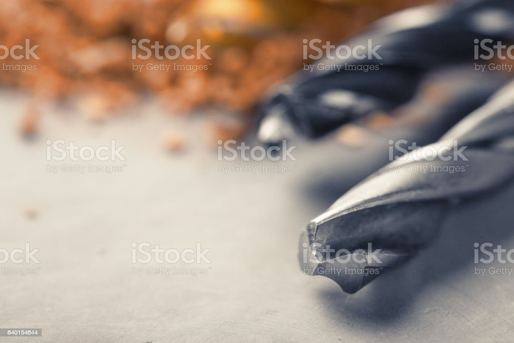 new drill bit set lying on clean concrete background stock photo