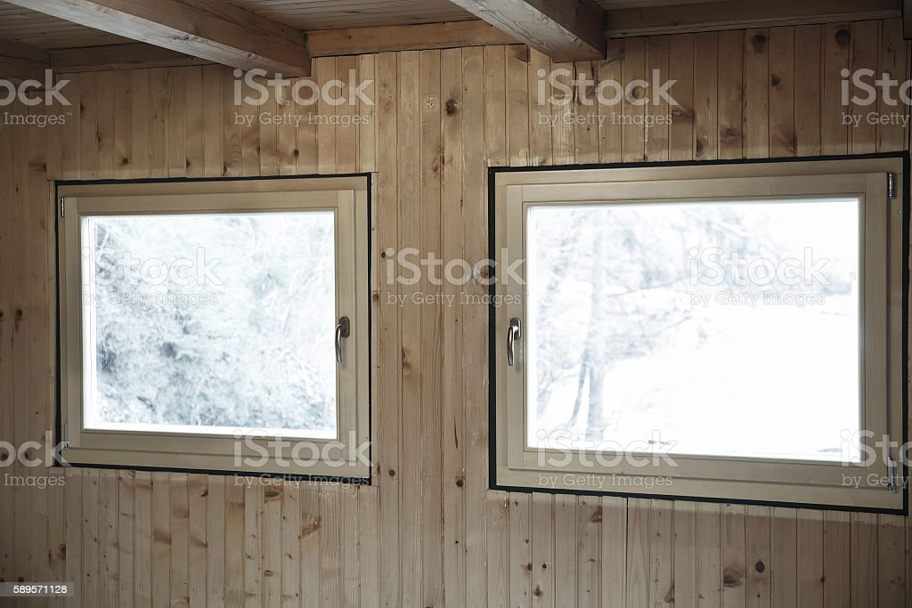 New efficient windows installed in wooden house stock photo