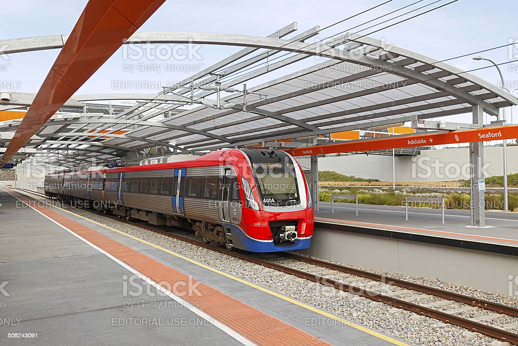 New electric train at modern suburban station stock photo