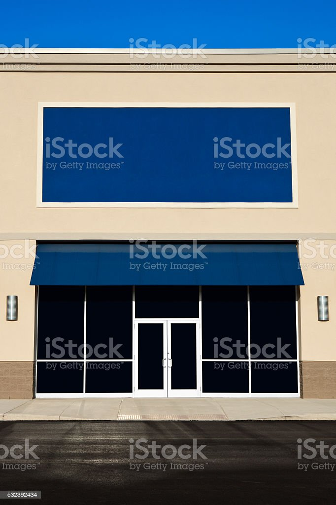 New Empty Store Front With A Blank Sign stock photo