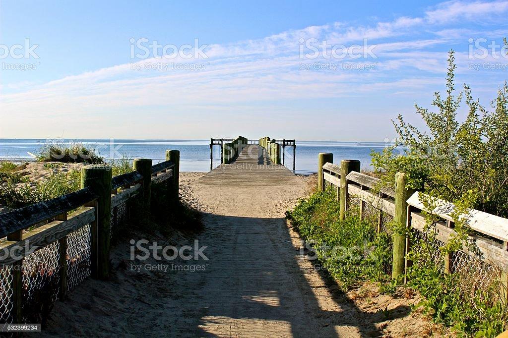 New England Beach Scene with Pier stock photo