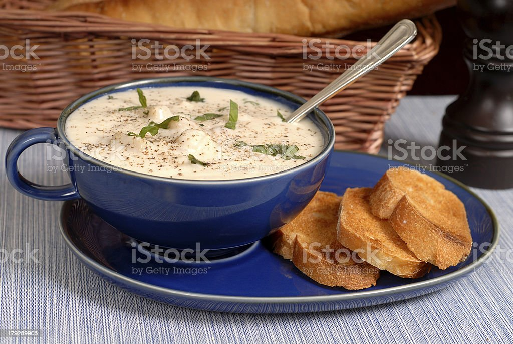 New England Clam Chowder in a blue bowl stock photo